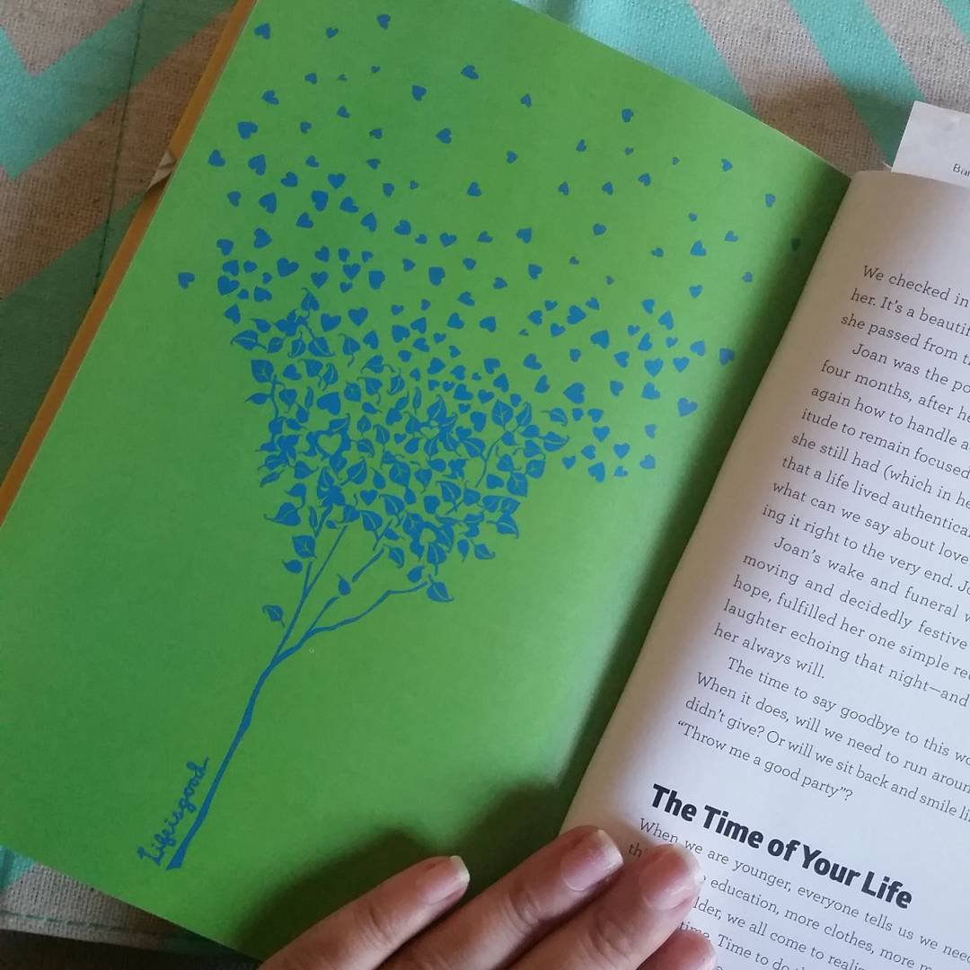 An open Life is Good Book showing a tree graphic design.