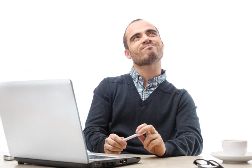 Man looking up thinking over a white background.  Symbolized contemplating ideal job.