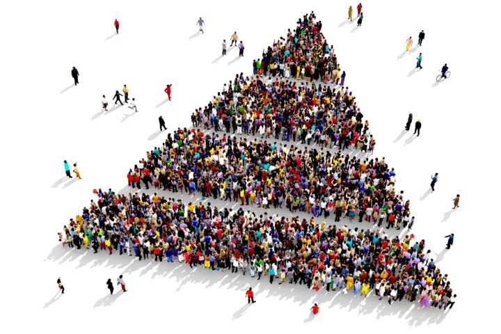Large and diverse group of people seen from above, gathered together in the shape of a layered pyramid, 3d illustration