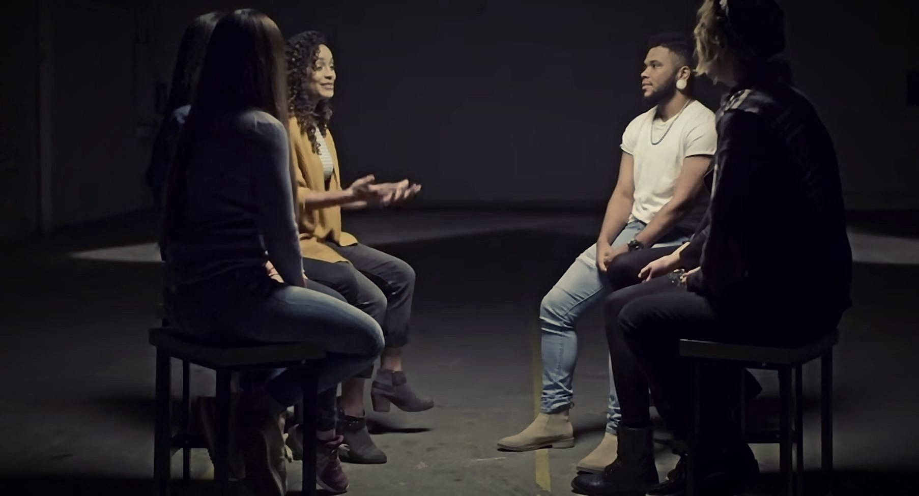 A group of people talking about a topic in Jubilee Media's Middle Ground Series.
