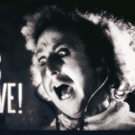 Gene Wilder in character for Young Frankenstein yelling It's Alive!