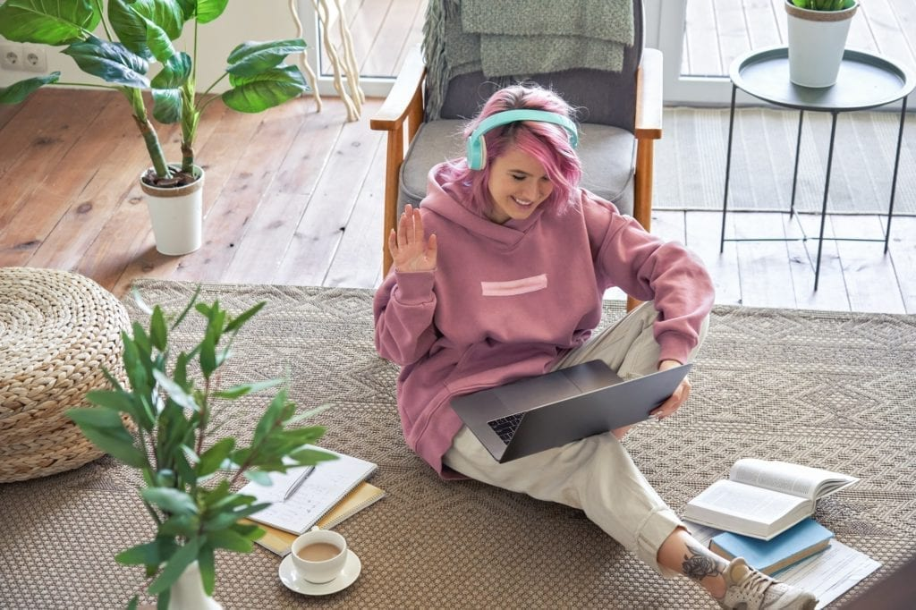 A woman relaxing and WFH (work from home) while on her laptop.  Meant to symbolize professional growth while not working at the office.