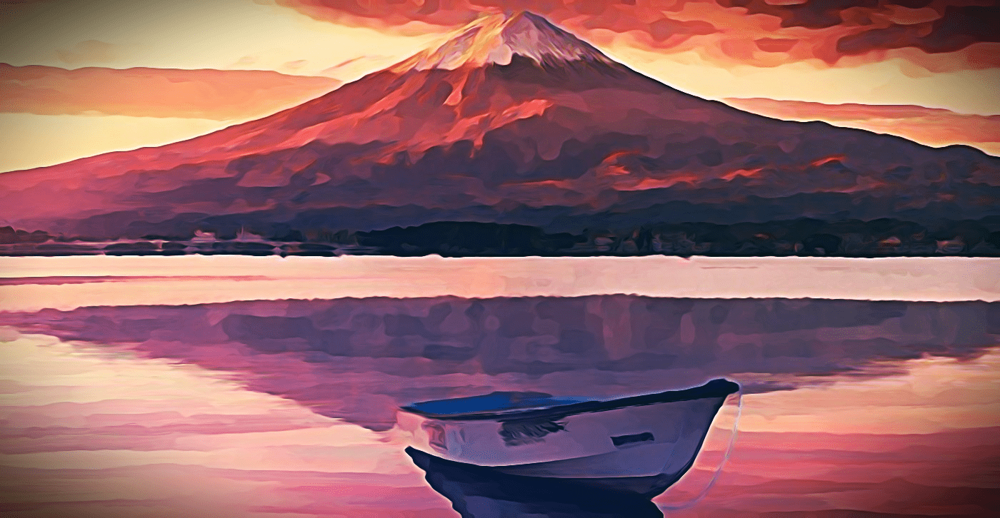 A picture of a boat in front of a mountain.