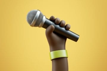 A 3D model render of a Black cartoon hand holding a microphone up over a yellow background.