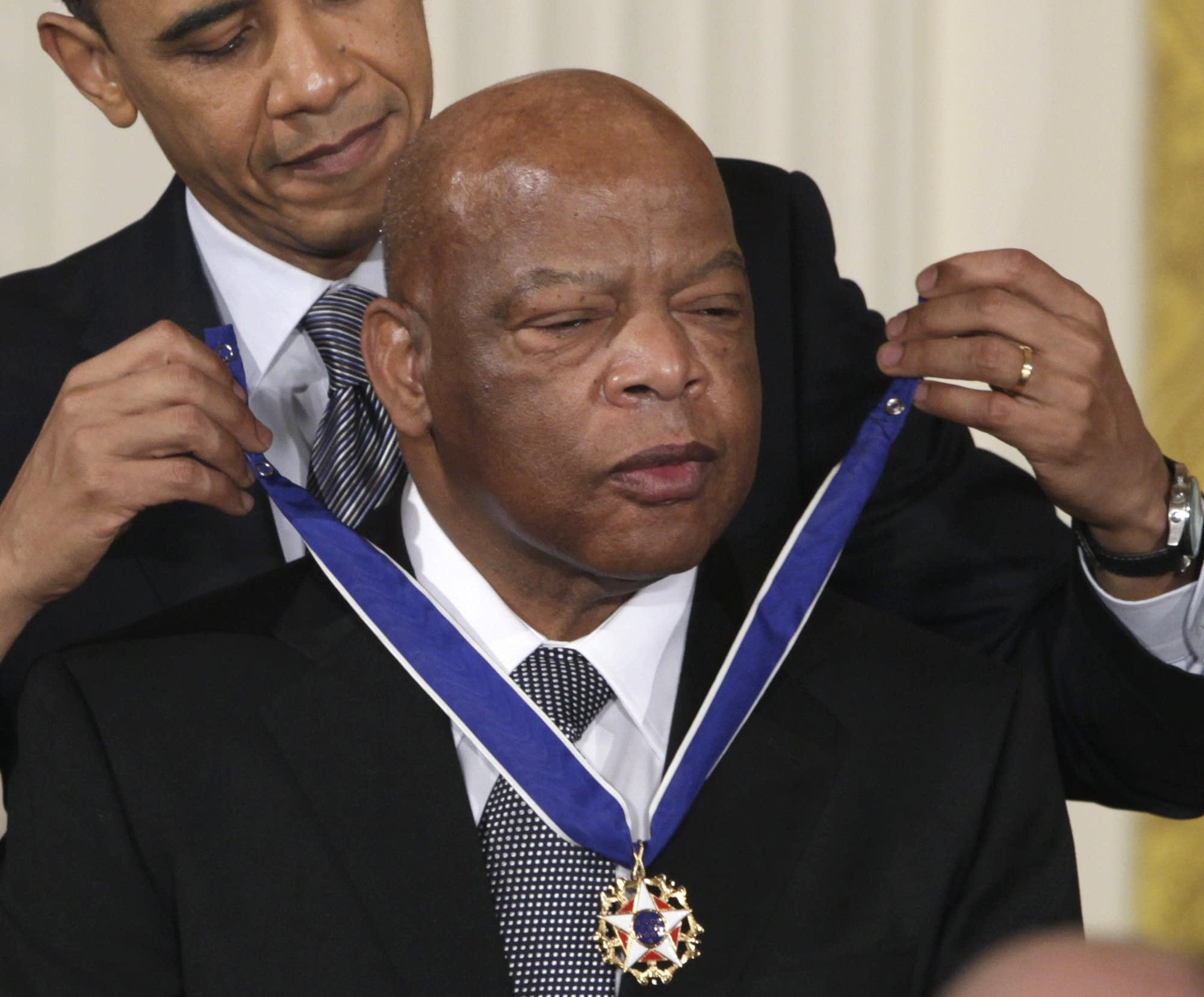 President Barack Obama awards the 2010 Presidential Medal of Freedom to Congressman John Lewis in a ceremony in the East Room of the White House.