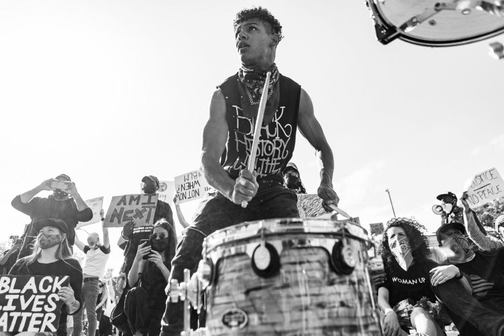 Hollywood, CA / USA - June 2020: Protestor drumming in Black Lives Matter / George Floyd Protest in Hollywood