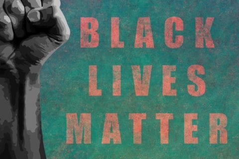 Black lives matter. Black fist raised with a powerful anti-racist message calling for equality.
