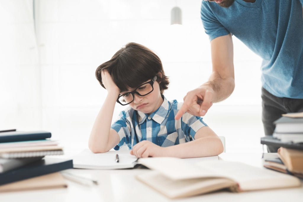 Father helps his son to do homework in school. He suggests how to do it right. The boy feels tired. He's in a bad mood.  Symbolizes a lack of productivity.
