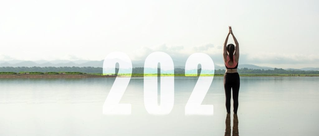 A graphic showing the number 2021 with a woman doing a Yoga pose representing the place of the number one.