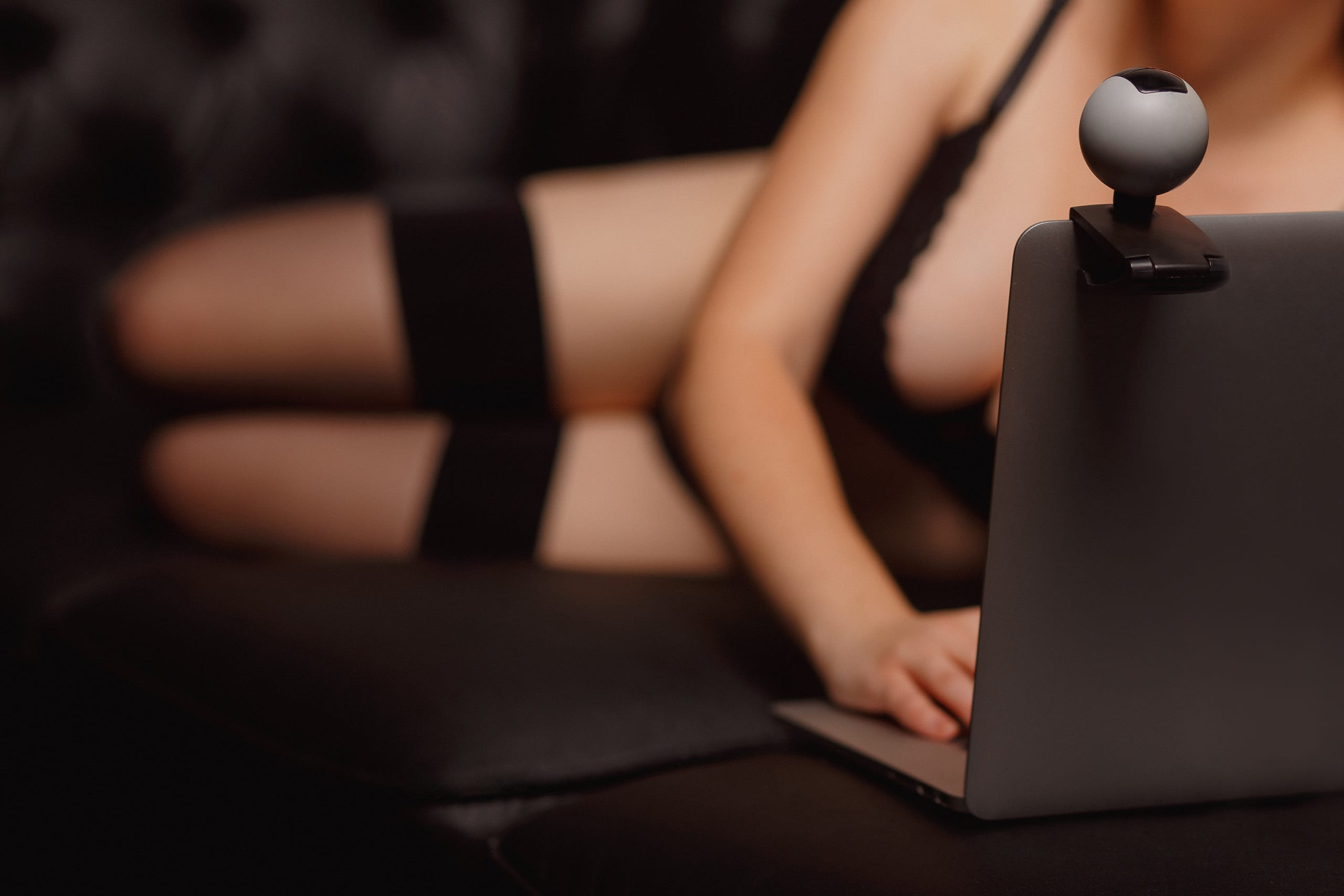 Woman working as Internet webcam model. Shows breasts. Concept virtual sex chat.