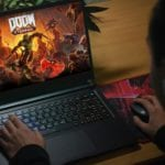 Kyiv, Ukraine; April 20, 2020: The guy plays on the notebook in Doom Eternal.
