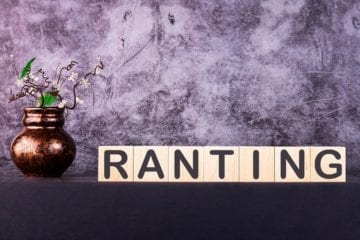 RANTING word made with wooden building blocks on a grey background