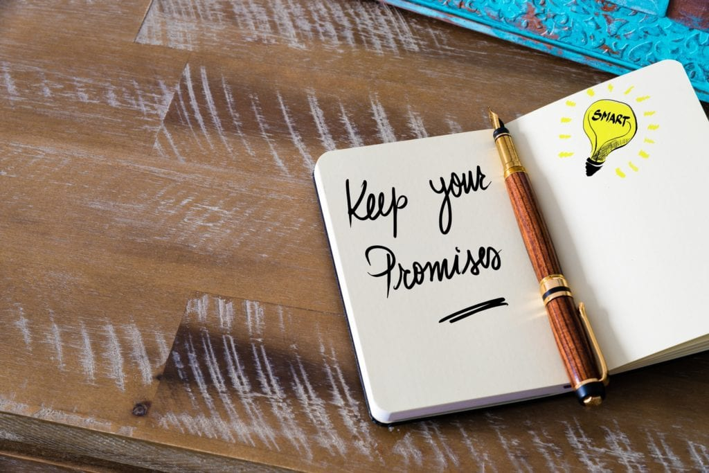 Handwritten text Keep Your Promises with fountain pen on notebook.