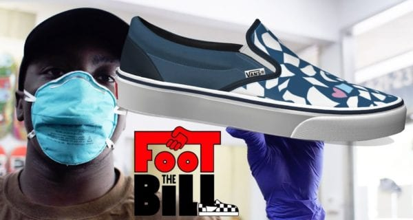 A Black man wearing a mask and gloves holding a custom VANS slip-on sneaker (Foot The Bill).