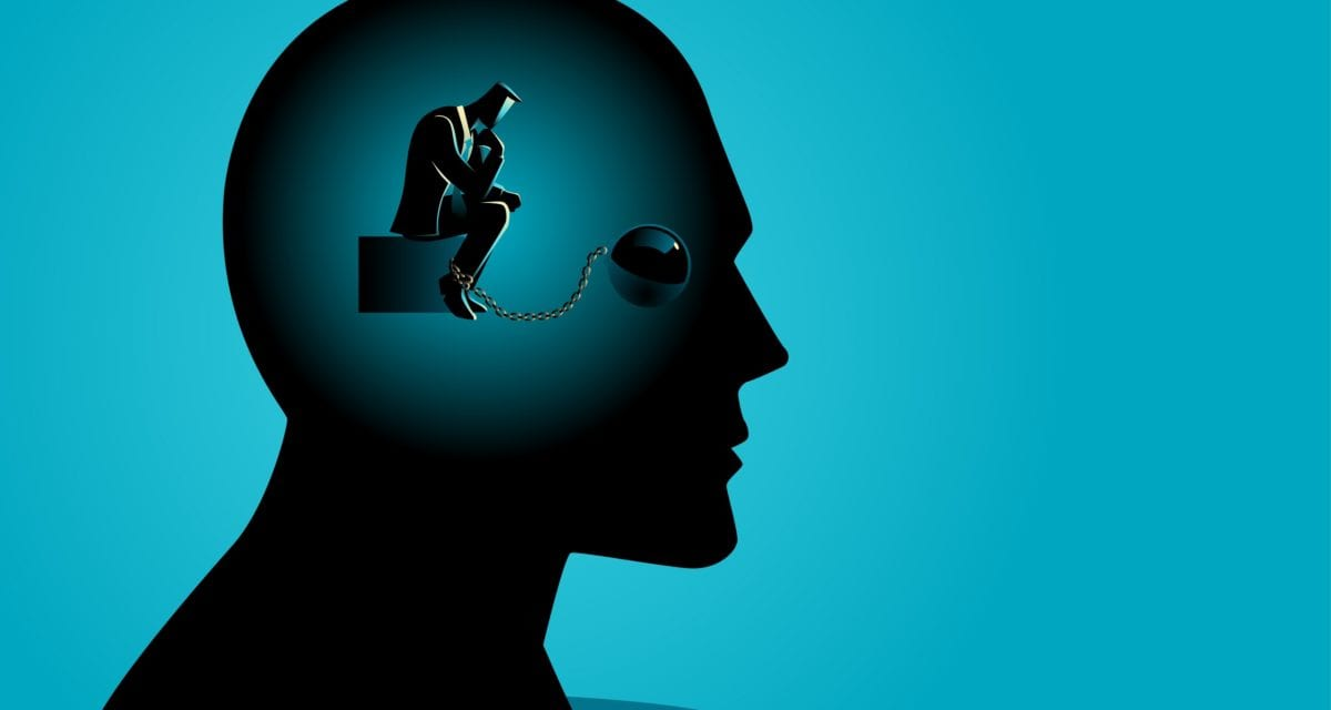 Business concept vector illustration of a businessman in human head being chained, tied up thinking, struggle, lack of creativity, chained thoughts in business concept