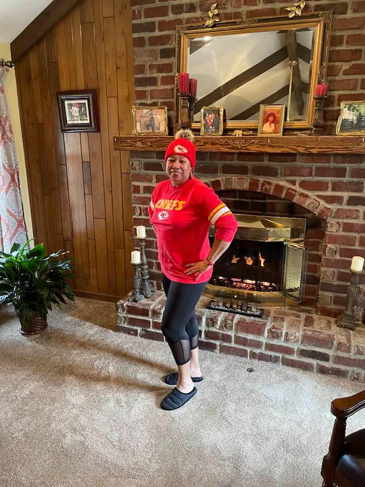My mother wearing Kansas City Chiefs clothing