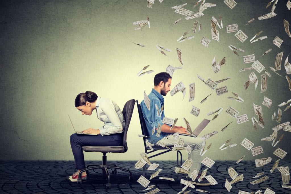 Woman working on laptop sitting next to young man under money rain. Pay difference concept.