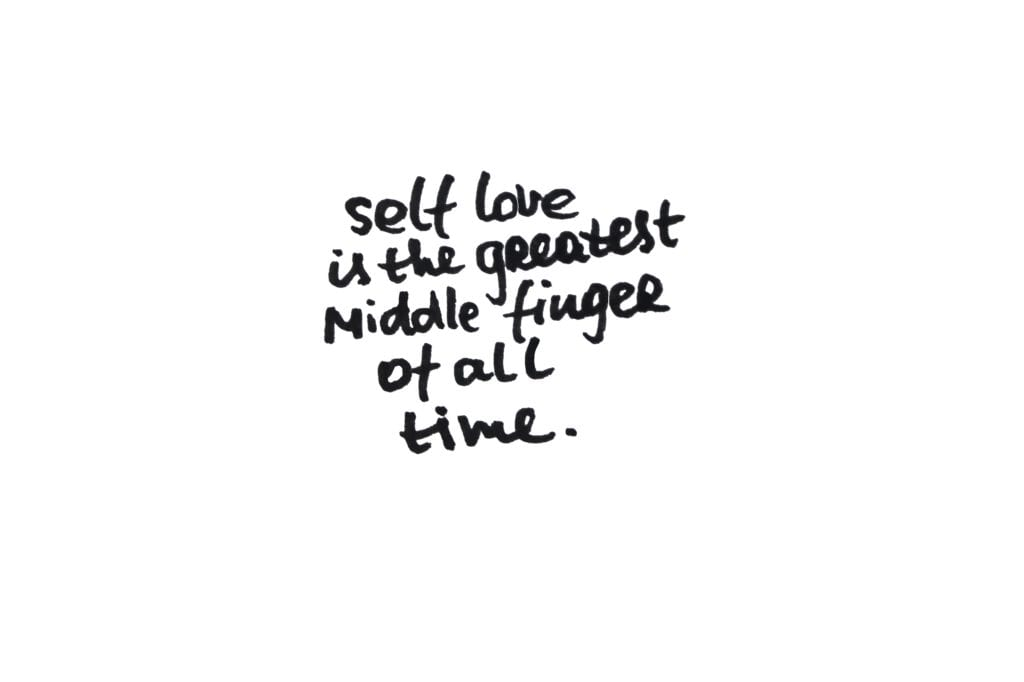 Self love is the greatest middle finger of all time. Handwritten message on a white background.