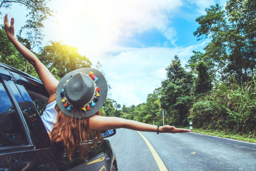 Asian women travel relax in the holiday. Traveling by car park. happily With nature, rural forest. In the summer